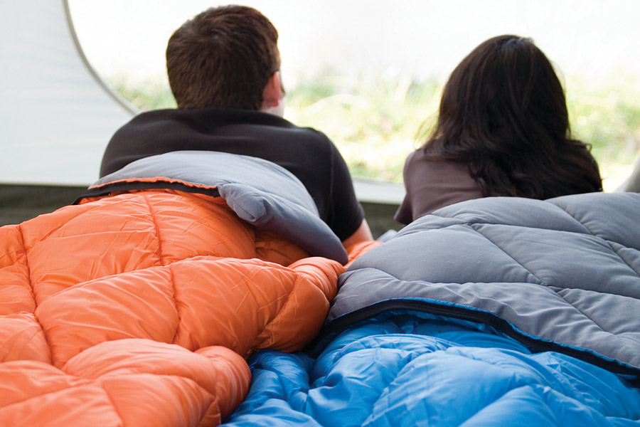 Couple cosy in their individual sleeping bags