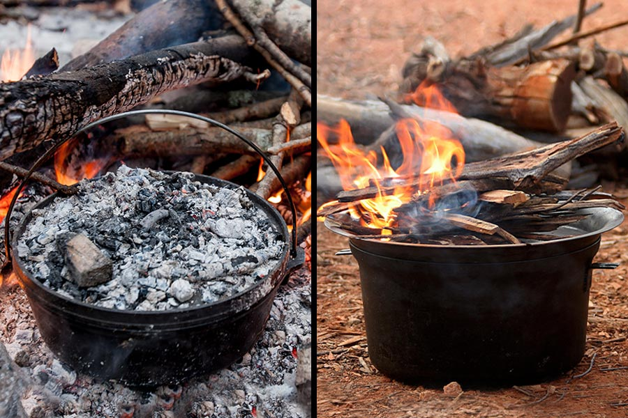 A cast iron camp oven with hot coals next to a spun steel camp oven with lit firewood