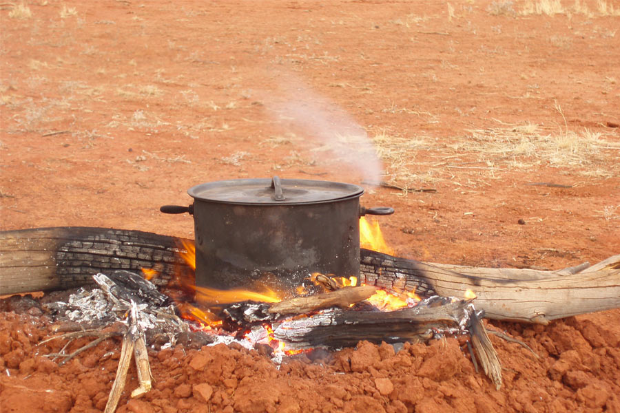 Cooking in camp oven on open fire