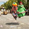 Two clowns skipping at the Adelaide Credit Union Christmas Pageant