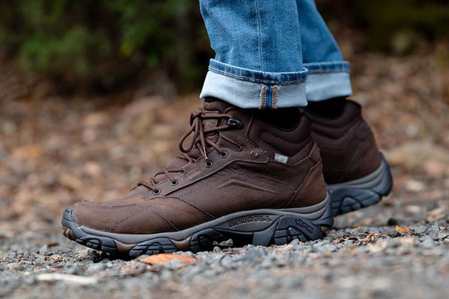 A close up of a pair of brown Merrell boots