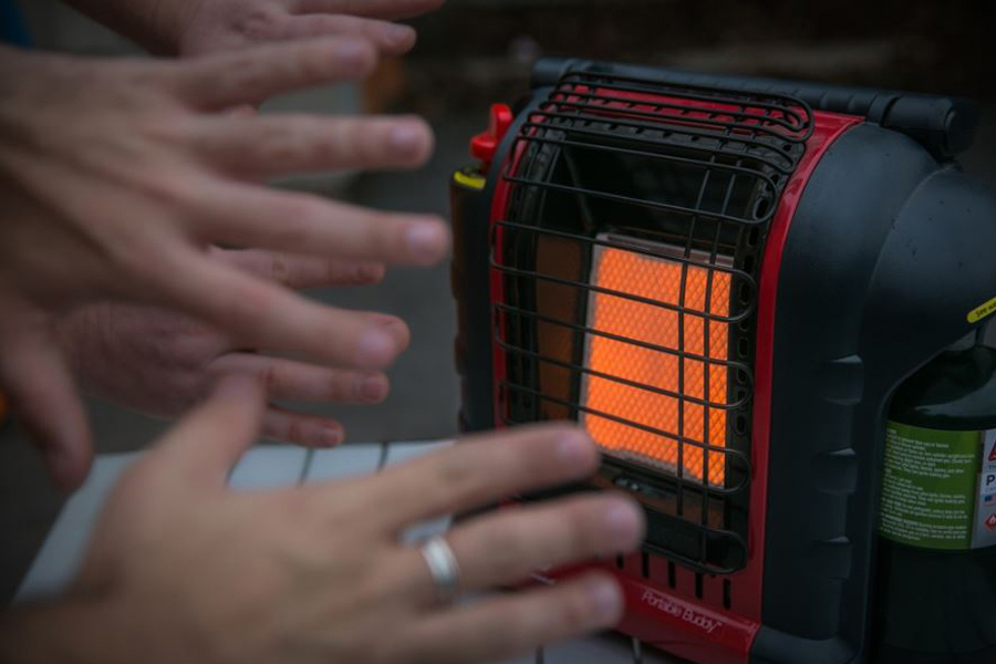 Keep your hands warm in front of a Portable Gas Heater