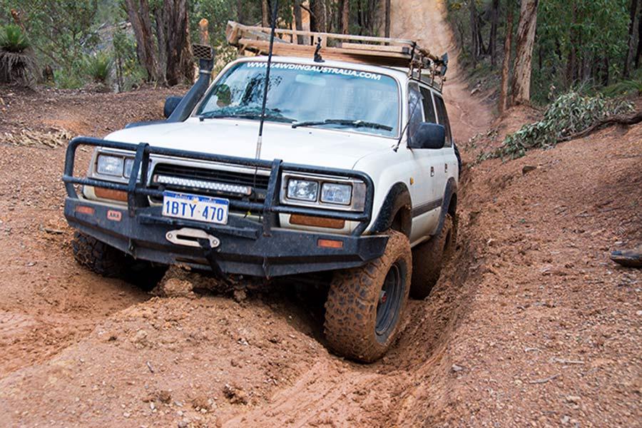 Toyota LandCruiser climbing a muddy hill in Australia