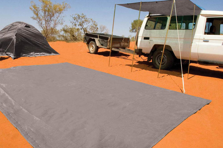 Groundsheet laid out flat on the sand