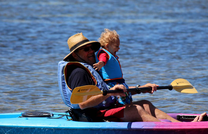 a sit on top kayak and kid