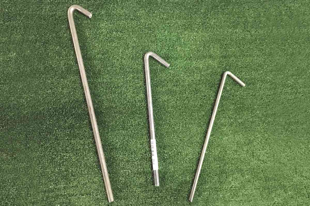 Three sizes of steel tent pegs