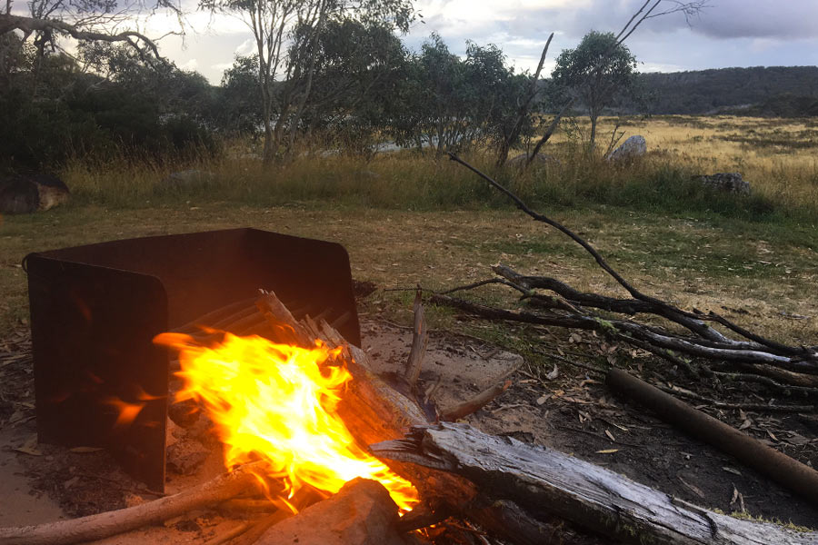 Small campfire with wet wood out in the bush