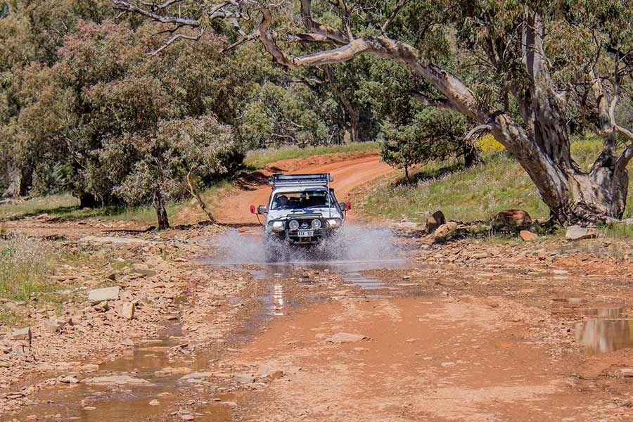 Driving in the 4WD along a muddy track