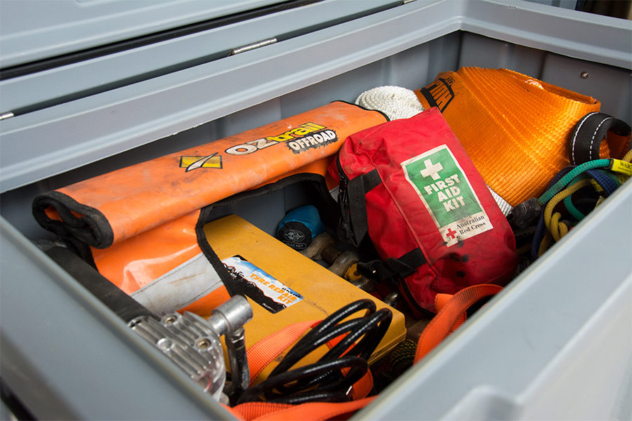 Compressor, recovery gear and a first aid kit