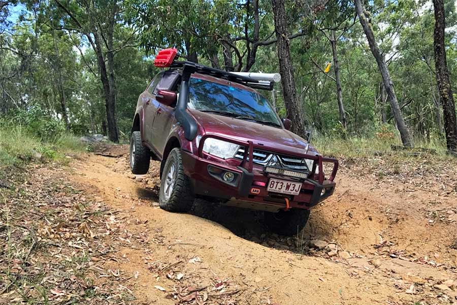 Challenging 4WD driving on track outdoors