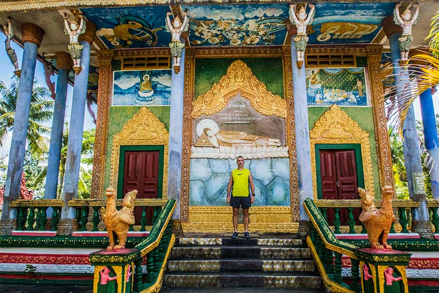 Standing on steps of temple