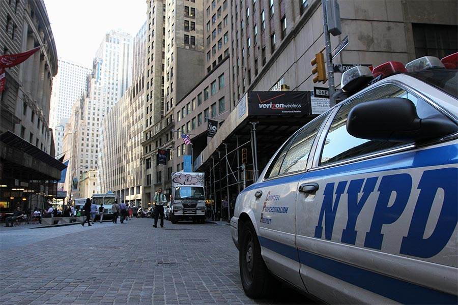 Parked NYPD car on Wall Street in NYC