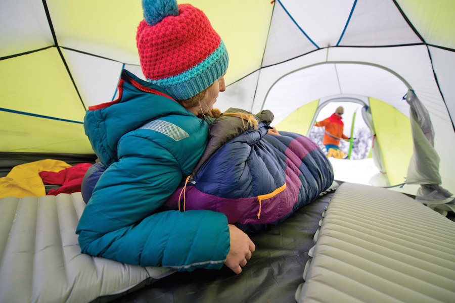 Woman sleeping on Thermarest mat in tent