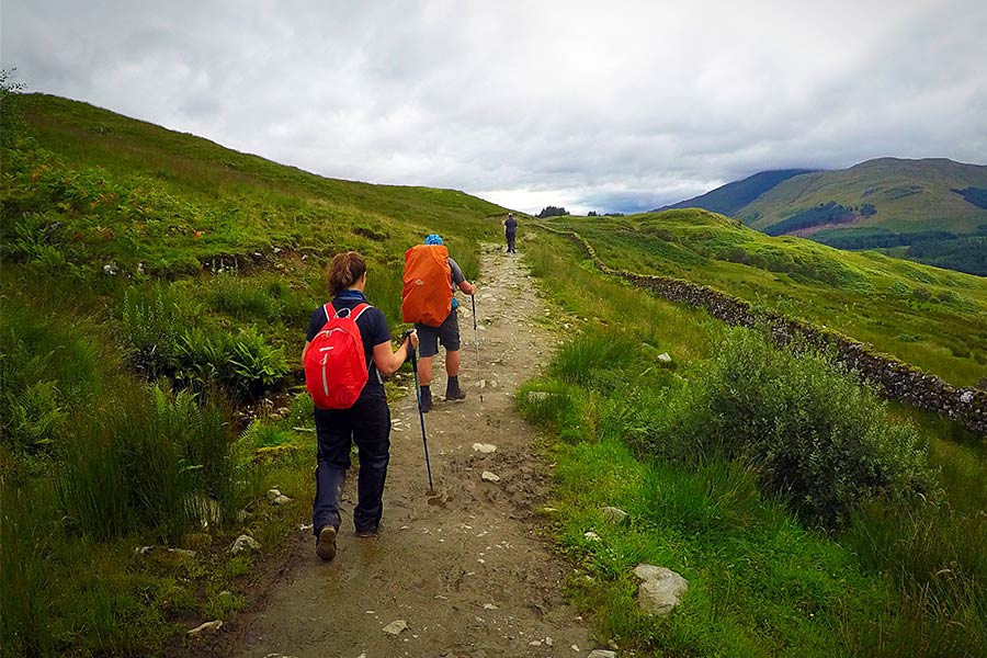 Hikers walking the West Highland Way route.