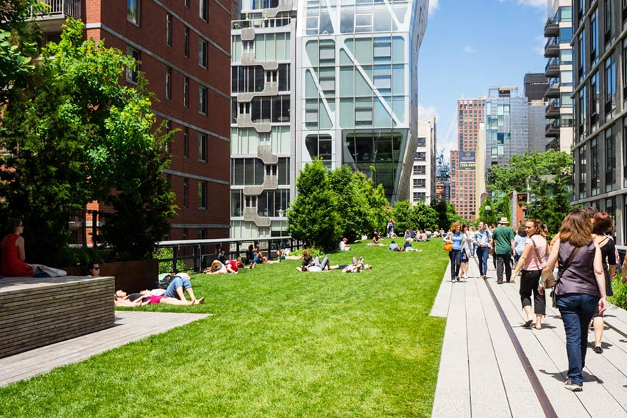 People walking and relaxing along the High Line in NYC.