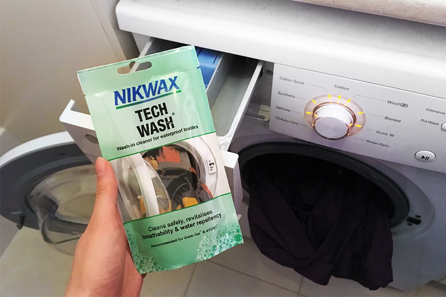 Using a cleaner suitable to wash a waterproof jacket.