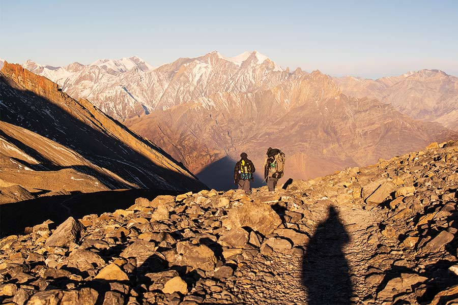 Two men looking at the incredible mountain scenery on the Annapurna circuit