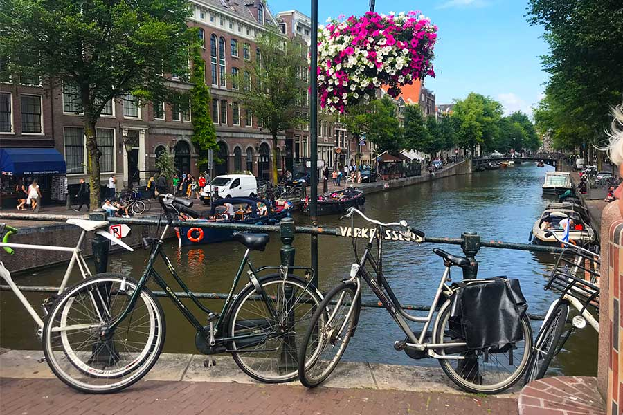 Bikes parked alongside a canal in Amsterdam