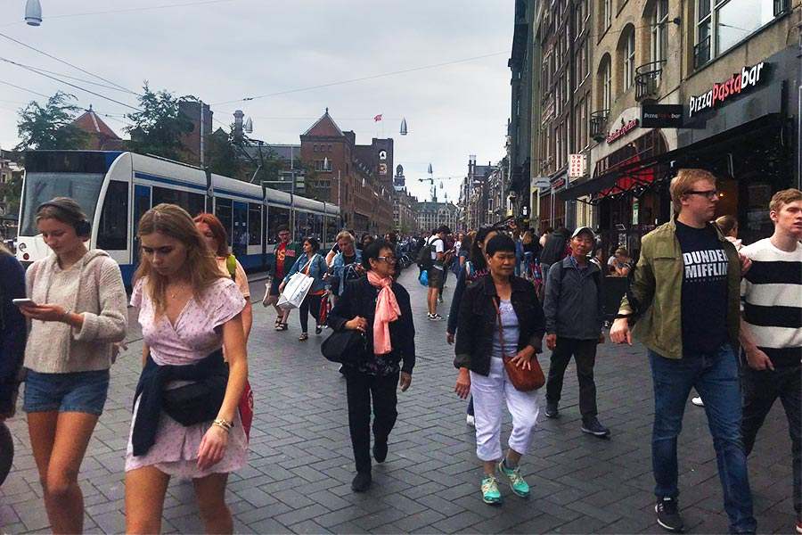 People walking the streets of Amsterdam