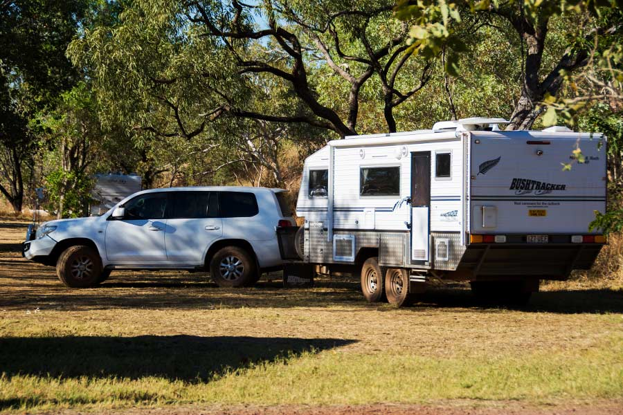 4WD parked with a caravan attached to it outdoors