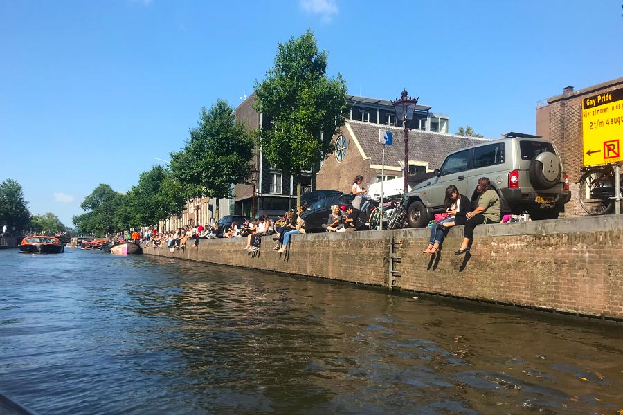 People having picnics by an Amsterdam canal