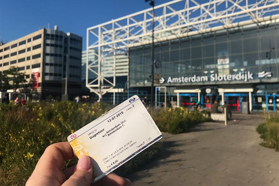 Holding my ticket up next to Amsterdam Sloterdjik Train Station