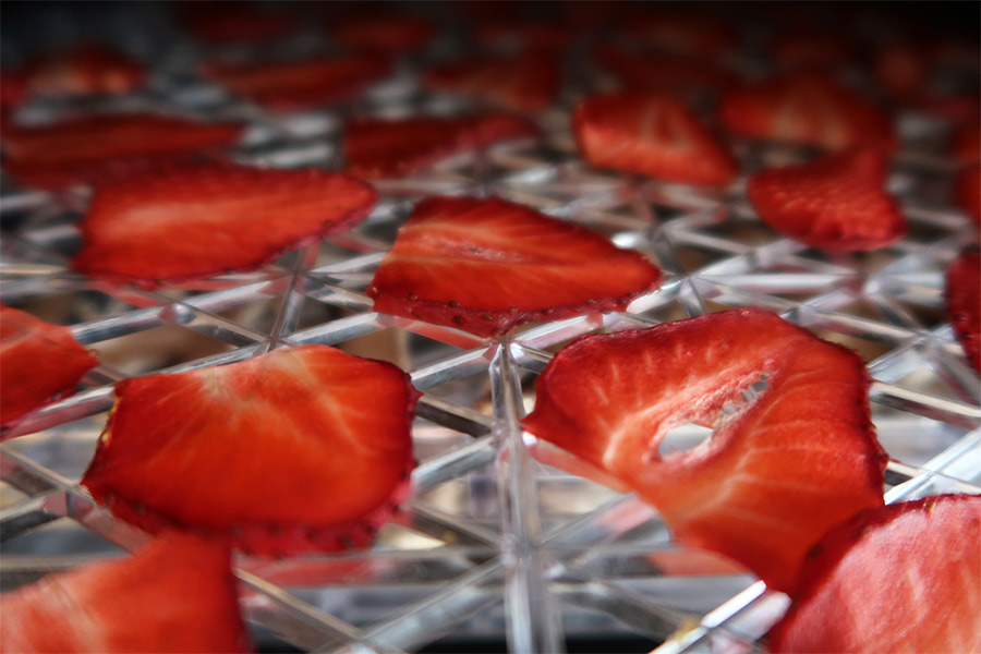 Sliced up strawberries on tray