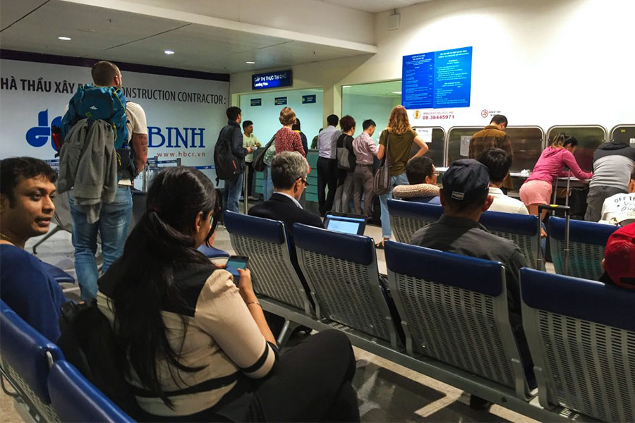 People lining up at Tan Son Nhat International Airport for a tourist visa