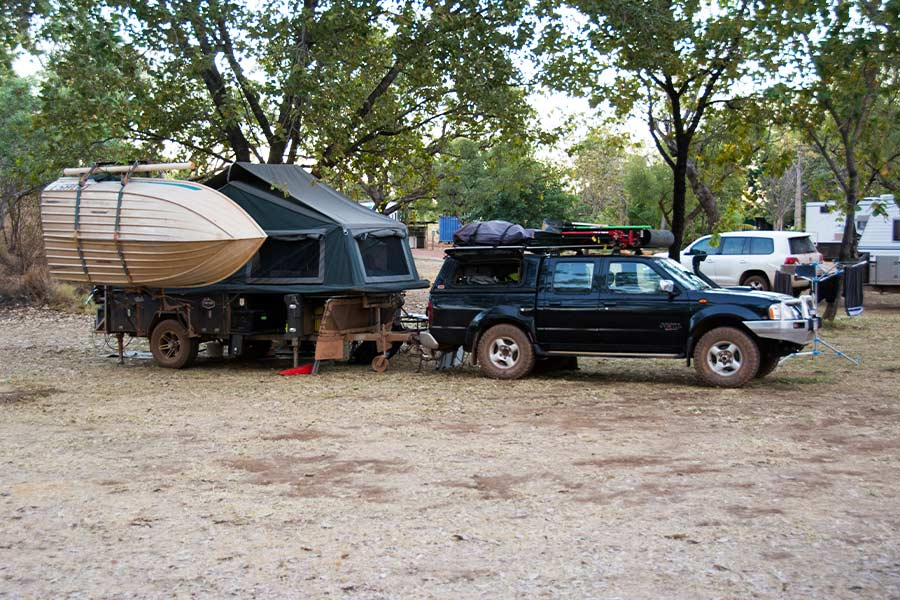 4WD parked with a camper trailer and boat on the end
