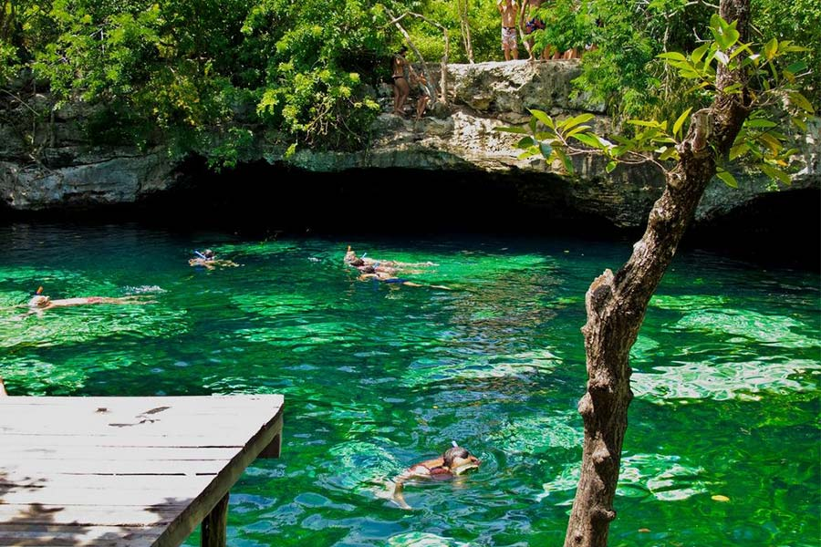 People snorkelling in the cenote caves in Mexico