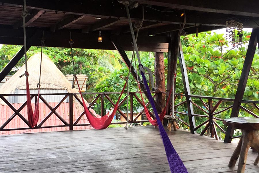 Hammocks hanging from outdoor ceiling in Mexico