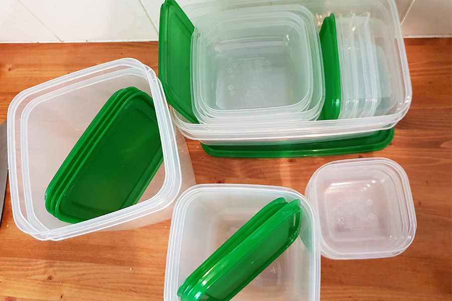Green and white plastic containers for food