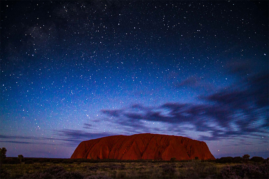 View of Uluru under the stars at night