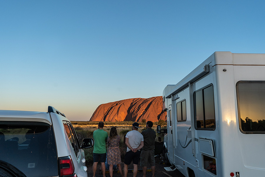 People viewing Uluru at sunset