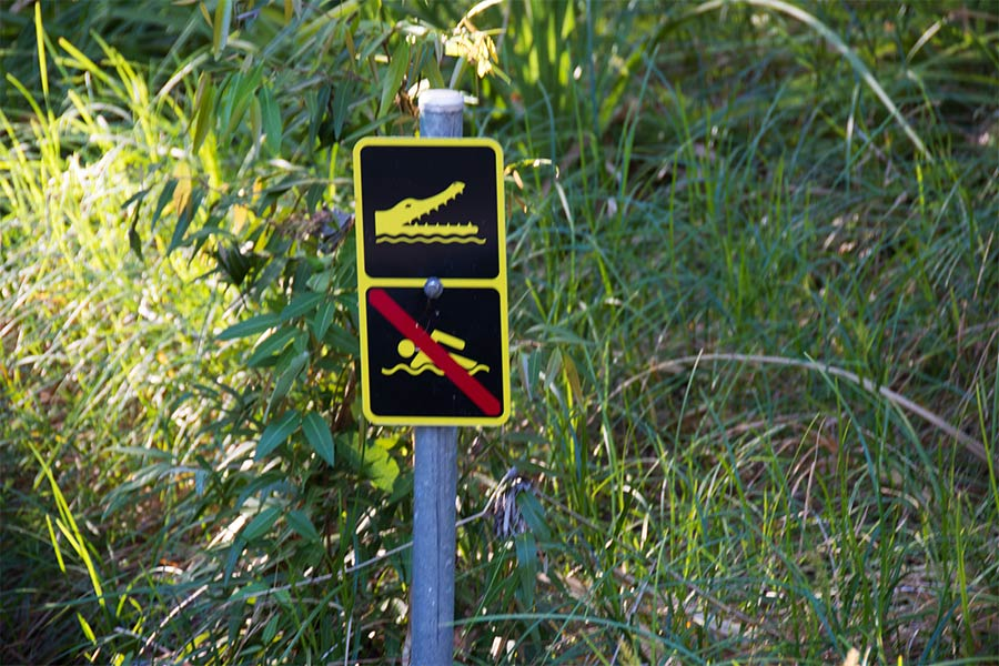 Typical crocodile warning signs up north of Australia