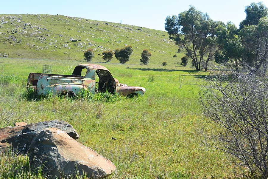 You will see an old, rusted car along the Lavender Federation Trail