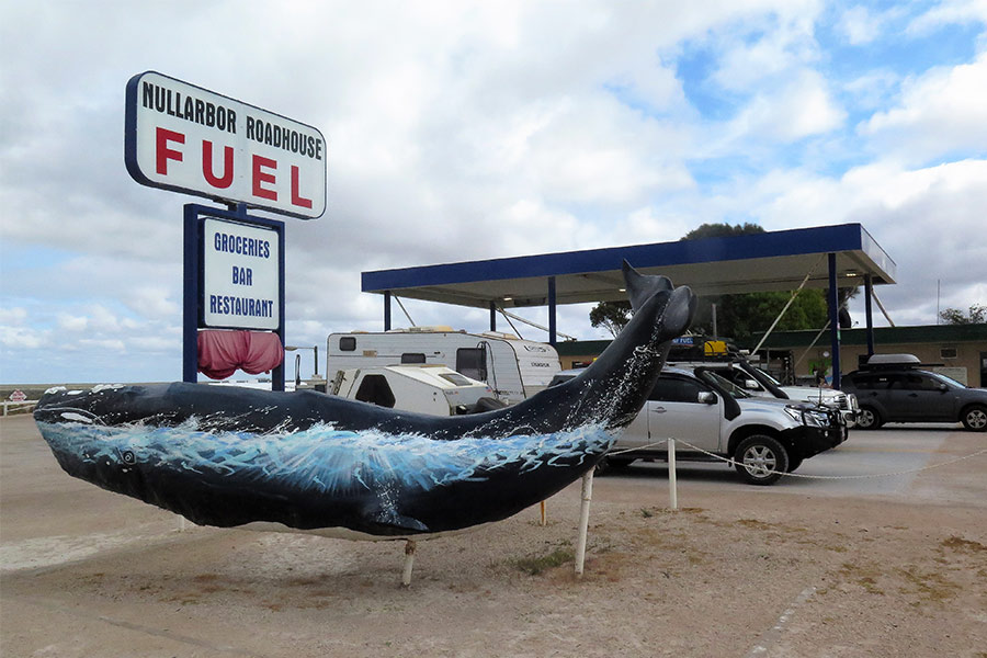 View of vehicles filling up petrol at roadhouse