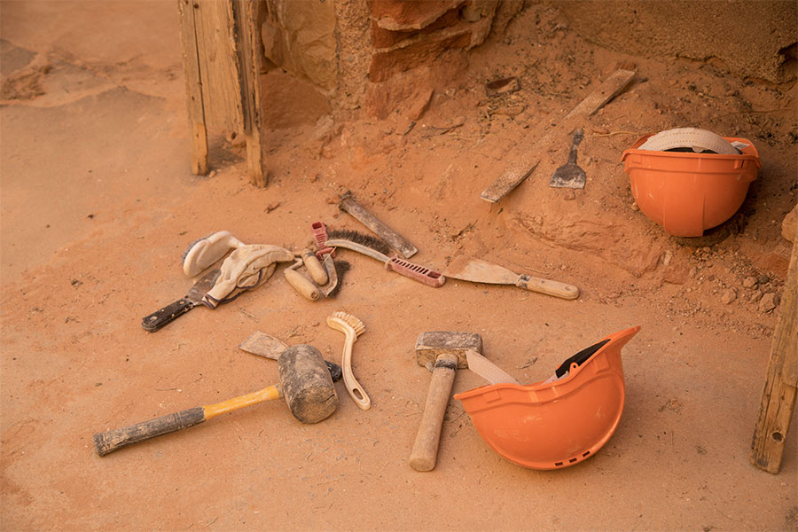 Restoration tools lying on the dirt in Farina