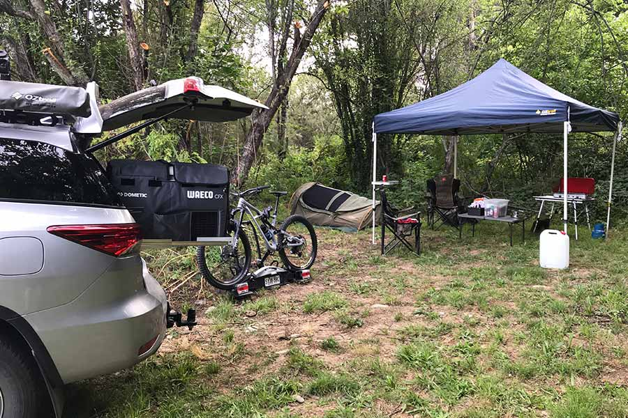 Campsite setup near vehicle