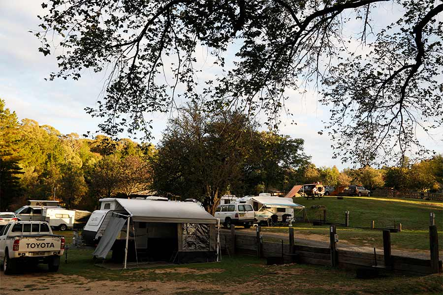 Caravans, vehicles and tents at Village campground in Hill End