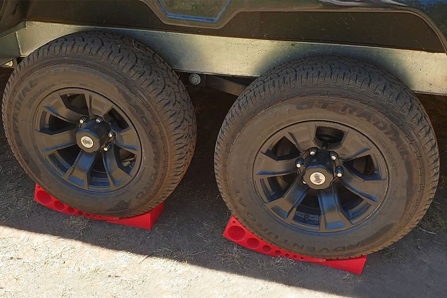 Two caravan tyres resting on wheel chocks