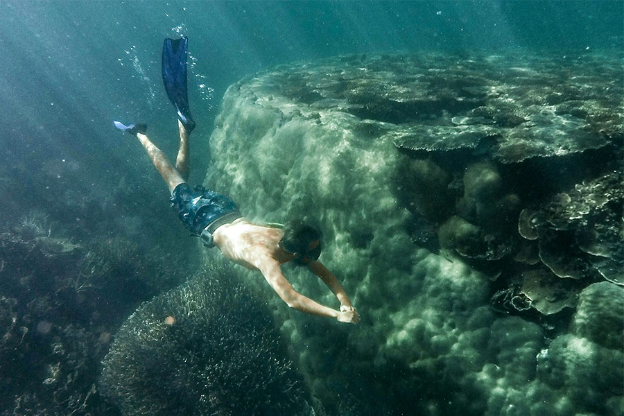 Man diving underwater at Ayer's Rock