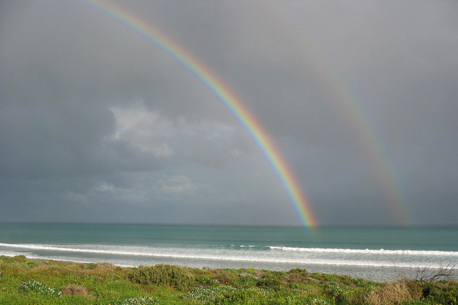 Two rainbows over the ocean