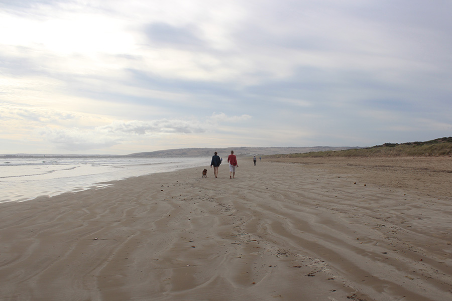 Friends walking along western end of Goolwa Beach