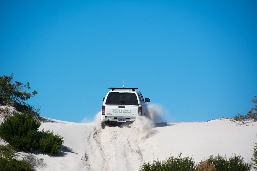 4WD driving on sand up a hill