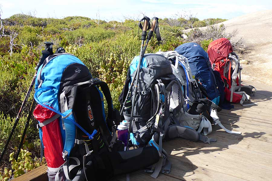 Hiking packs lined up along the Kangaroo Island Wilderness Trail