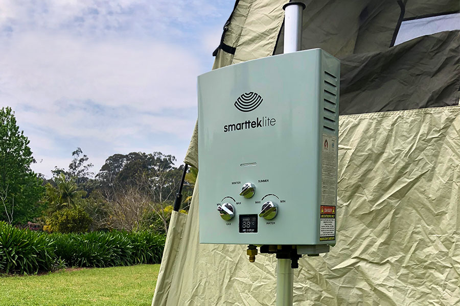 Smarttek Lite Hot Water Unit next to Smarttek shower tent outdoors
