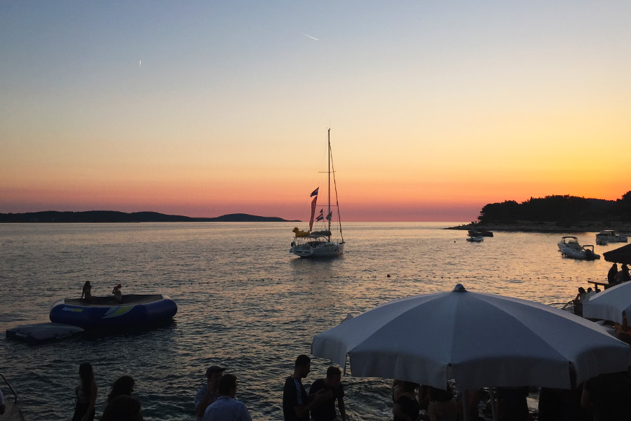 View of boats on the ocean at sunset in Croatia