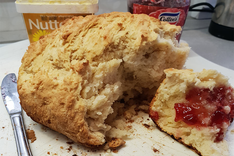 Damper with butter and strawberry jam