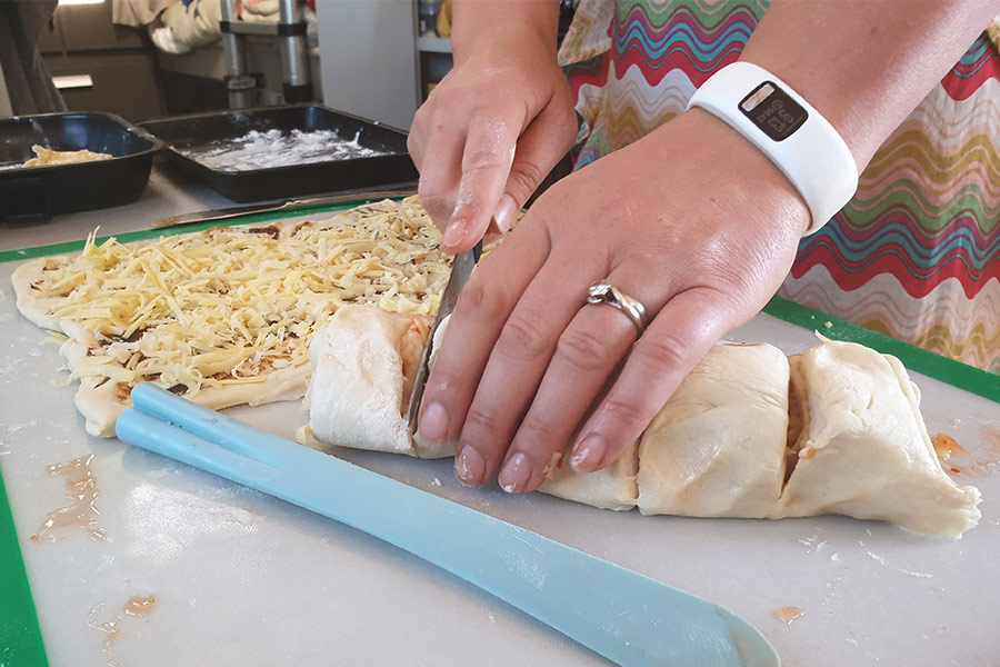 Cutting rough dough in the caravan kitchen for cooking